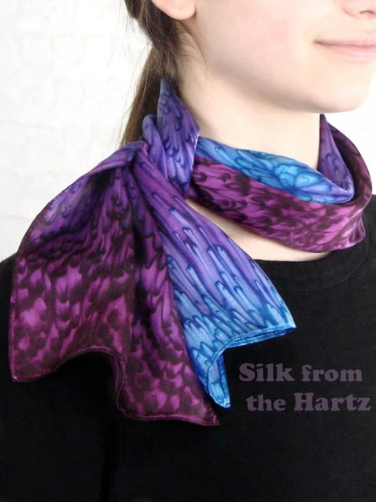 Beautiful purple, lavender, plum and violet silk scarf tied to the side.  Hand dyed by Warren Hartz, the artist.