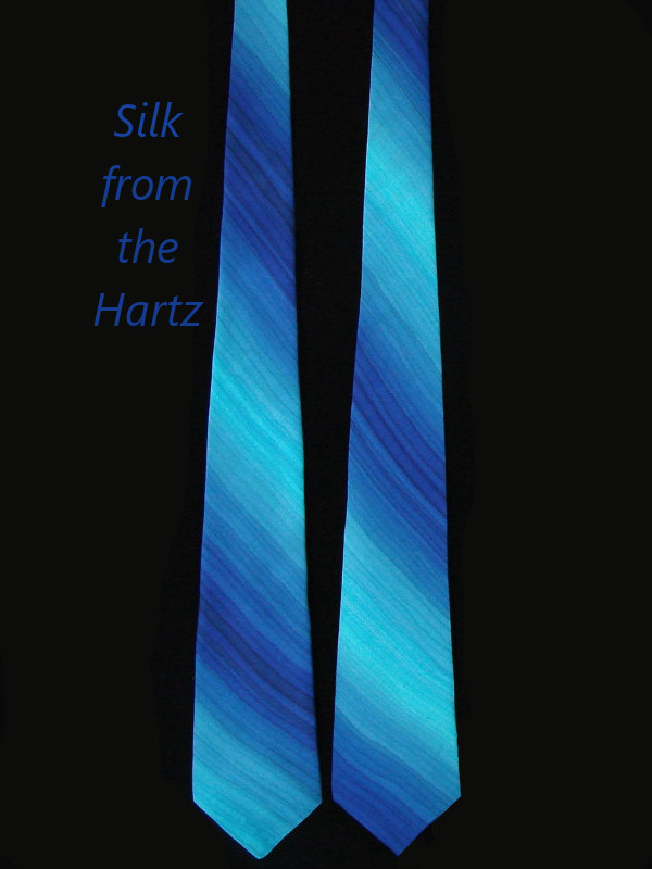 Blue silk men's necktie hand painted with unique royal and turquoise diagonal stripes.