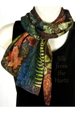 Gift shop store botanical gardens hand dyed leaf print silk scarf in autumn colors for fall fashion for women.