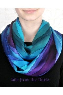 A classy silk designer infinity scarf, hand dyed with jewel tone stripes of blue, green and purple on the best soft silk satin.