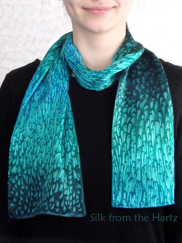 Cool turquoise and teal green colored silk satin scarf with elegant raindrop design