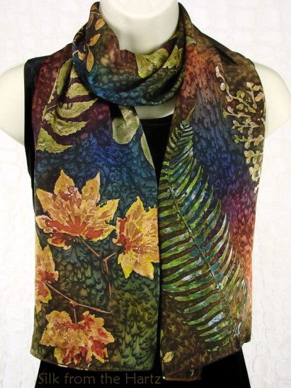 Unique silk scarf hand printed using real leaves, then hand painted with earth tone dyes and sprinkled with salt for an original and creative design.