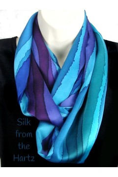 Enjoy the luxury of this classy elegant silk satin infinity loop scarf, with hand painted stripes of blue, green, and purple.