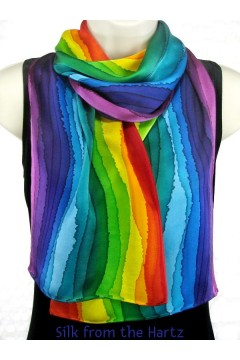 A colorful silk satin scarf hand painted with all the colors of the rainbow in a unique stripe design. Enjoy these bright elegant fashion scarves for women.