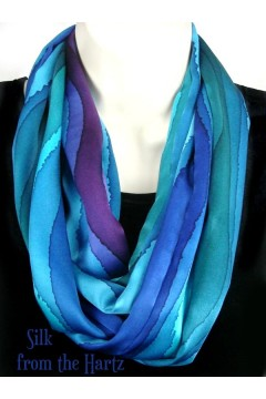 Give her a colorful, beautiful and unique gift, for mom, wife or any woman that loves cool blue, green and purple jewel tone colors, hand dyed in creative stripes on a hand dyed silk infinity scarf.