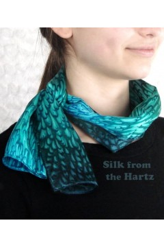 An elegant retirement gift for women, this unique teal green silk scarf is handcrafted, here shown tied in the front.
