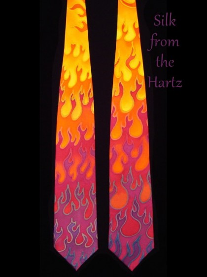 Hand painted silk hot rod flame men's wild necktie, in bright purple, red, orange, and yellow. Creative, unique, artistic design.