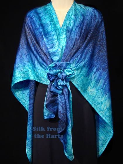 Elegant blue navy and turquoise hand dyed silk satin wrap held together in front with a scrunchie.