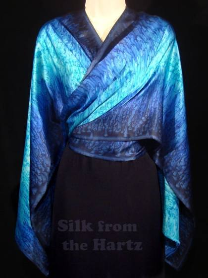 Elegant ladies evening wear fashion navy blue silk satin wrap shawl crossed over the front and tied behind the waist.